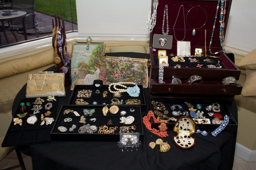 vintage jewelry set out at an estate sale
