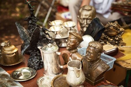 antique war busts and other vintage items at an estate sale
