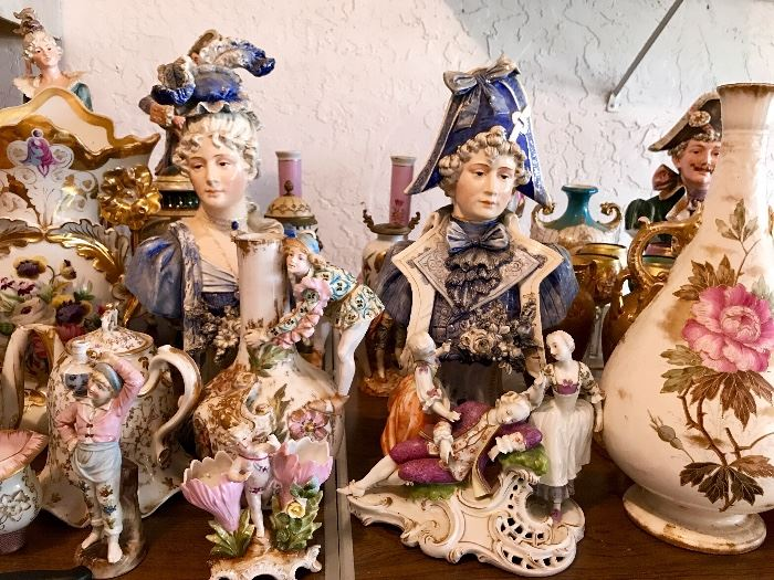 Porcelain figurines and vases displayed at an estate sale