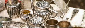 antique silver pots and utensils at an estate sale