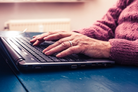 woman on laptop looking for estate sale company